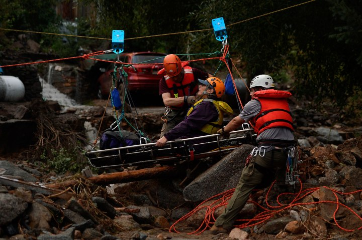 Darian Shaw of Salina being rescued by the Alpine Rescue Team using a high line and a sling across 4 Mile Canyon, she was brought across the rushing water with 3 other neighbors.