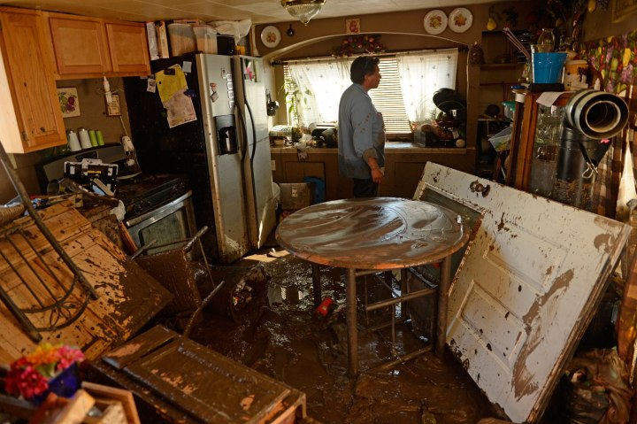 Evans, Colo., resident Rito Romero surveys the damage in his family's flooded home, on Sept. 16, 2013.