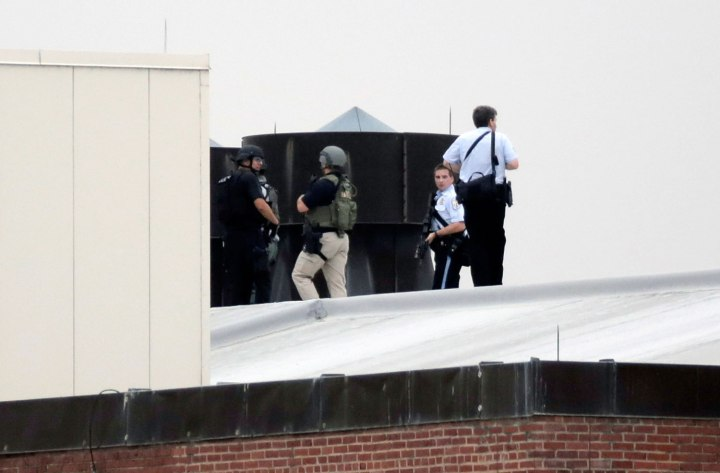 Law enforcement officers are deployed on a rooftop as they respond to a shooting on the base at the Navy Yard in Washington,D.C., on Sept. 16, 2013.