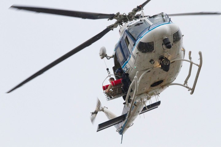 A U.S. Park Police helicopter removes a man in a basket from the Washington Navy Yard in Washington, D.C., on Sept. 16, 2013.
