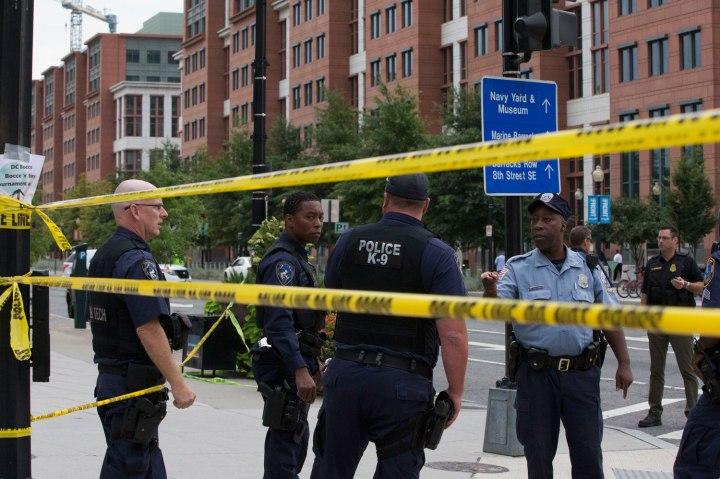 Police work the scene on M Street, SE in Washington, D.C., near the Washington Navy Yard on Sept. 16, 2013.