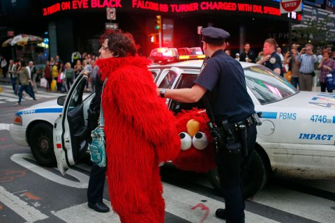 File picture shows Dan Sandler, dressed as Muppet character Elmo, being handcuffed and detained by police after using anti-Semitic language in Times Square, New York