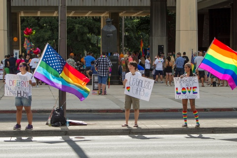 """Same sex marriage supporters waves signs during an """"All You Need is Love"""" rally at the Hawaii State Capitol in Honolulu"""
