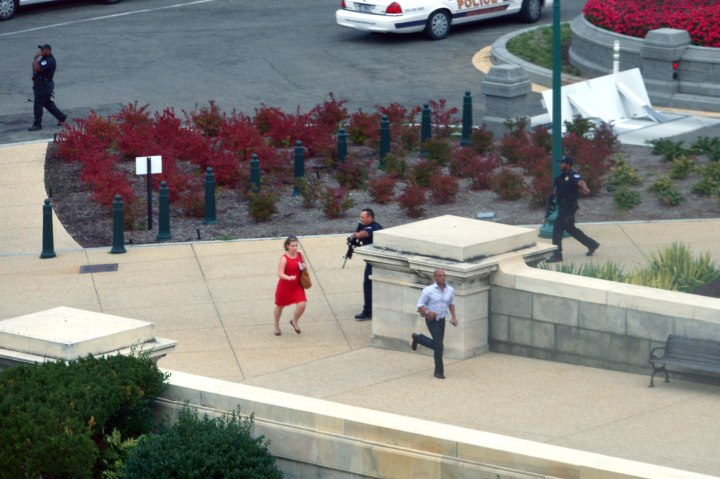 People run for cover as police converge to the site of a shooting October 3, 2013 on Capitol Hill in Washington.