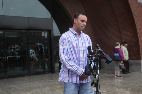 Tommy Donahue, son of alleged Bulger victim, addresses the media outside of the John Joseph Moakley U.S. Courthouse in Boston, Aug. 9, 2013.