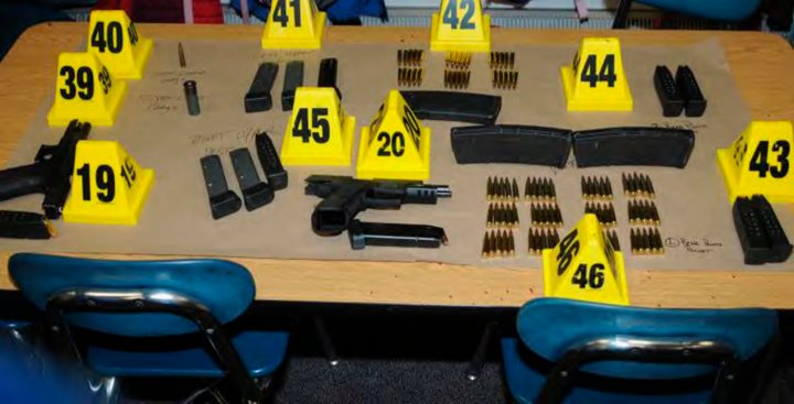 Weapons and ammunitions belonging to Sandy Hook Elementary school gunman Adam Lanza in police evidence photo