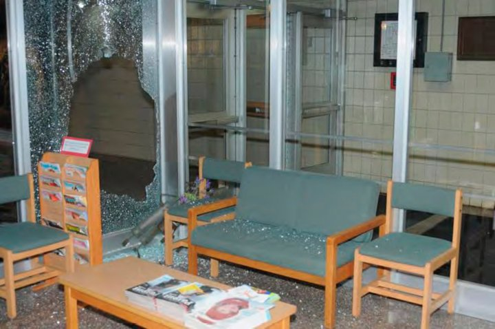 Shattered tempered glass pieces cover chairs and seats at Sandy Hook Elementary school in police evidence photo