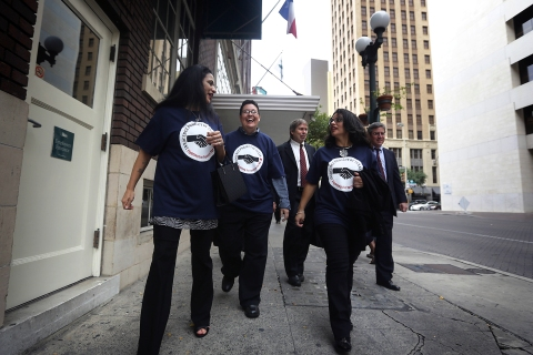 From left: Cassandra Rivera, Kristie Mayhugh and Elizabeth Ramirez, walk with two of their lawyers after a news conference on Nov. 20, 2013, in San Antonio.