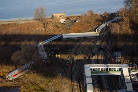 First responders gather around the derailment of a Metro North passenger train in the Bronx borough of New York Dec. 1, 2013.