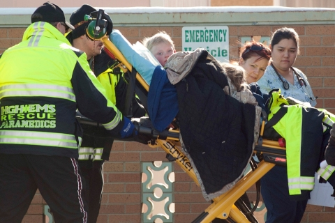 Members of a family that went missing are wheeled by stretcher from an ambulance into the Pershing General Hospital in Lovelock