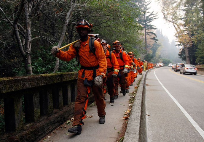 Firefighters deployed to contain a wild fire in Big Sur, Calif., on Dec.16, 2013.