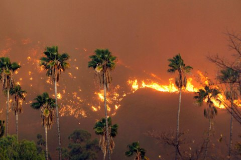A wildfire burns in the hills just north of the San Gabriel Valley community of Glendora, Calif.