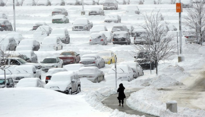 A woman walks in the long term parking lot at Indianapolis International Airport, on  Jan. 6, 2014.