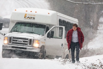 The driver of a Cherokee County Area Transportation System bus is sidelined in a ditch on Killian Road, Tuesday, Jan. 28, 2014 in Canton, Ga.