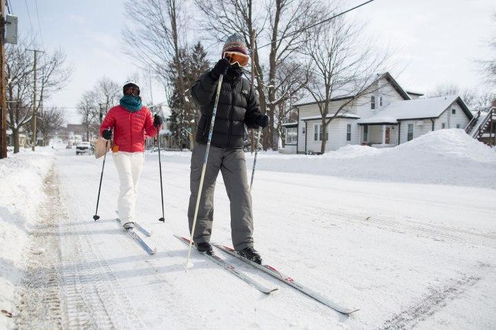 Celia Gargaro and her daughter Sarah ski up  West Madison street in Ann Arbor, Mich., on Jan. 6, 2014.