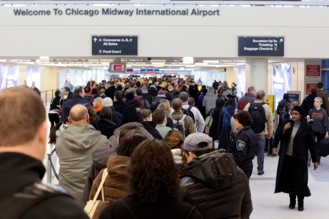 Long lines of passengers are at the TSA security check point at Chicago Midway International Airport, on  Jan. 6, 2014, in Chicago.