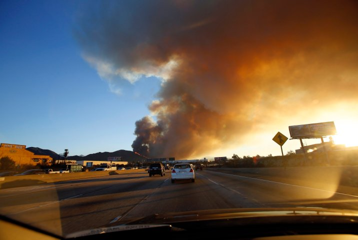 Smoke rises from the Colby Fire seen from the Foothill Freeway approaching Glendora