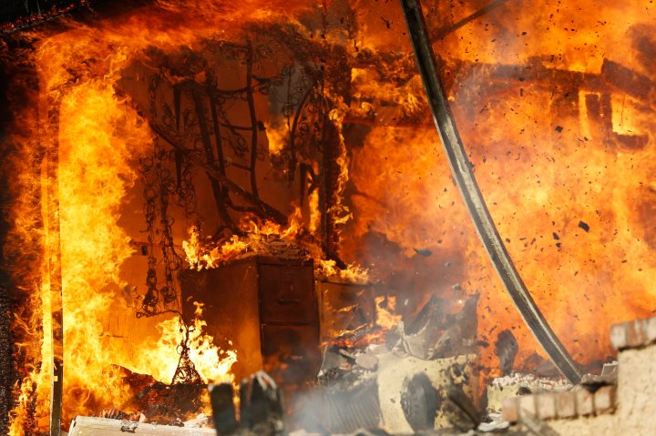 A home falls victim to the Colby Fire in Glendora, California