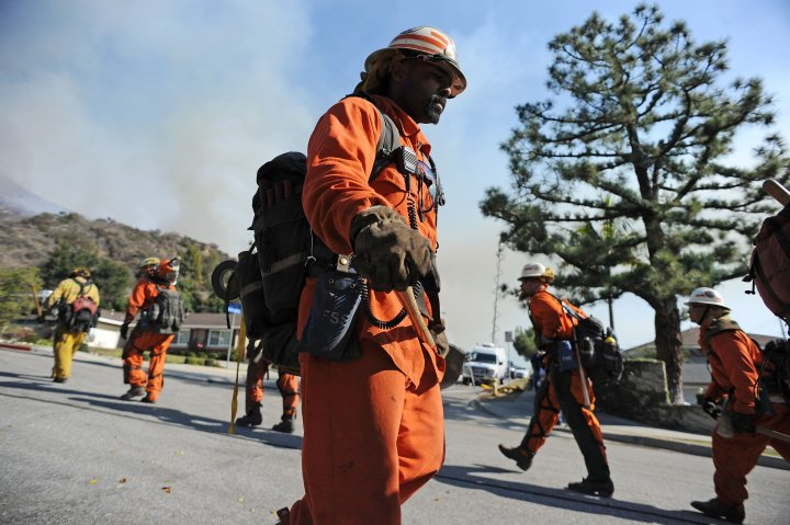 Firefighters prepare to attack the Colby Fire on January 16, 2014 in Azusa, Calif.
