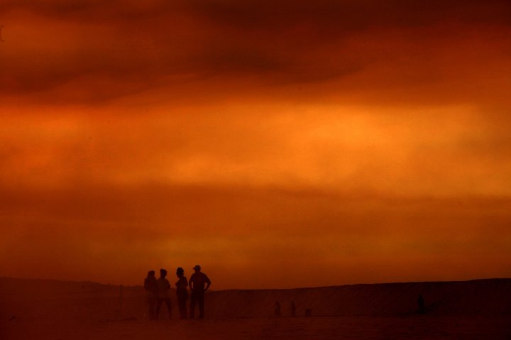 Smoke from the Colby Fire rises over beach goers at Playa Vista, Calif., January 16, 2014.