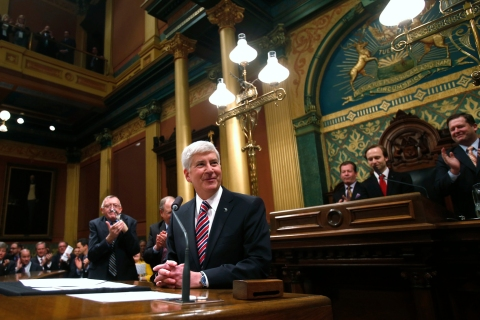 Michigan's Governor Snyder is acknowledged by the Assembly before his annual State of the State address in Lansing, Michigan
