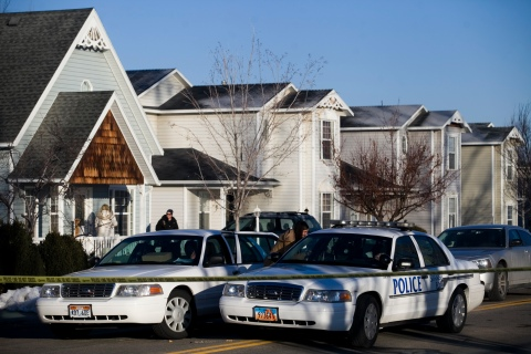 Police gather outside a home in Spanish Fork, Utah, Jan. 17, 2014, where five people were found dead on Thursday.