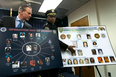 "From left: New York Attorney General Eric Schneiderman and New York City Police Dept. Chief of Department Philip Banks display a chart relating to the Super Bowl ""party packs"" at a news conference, in New York City, on Jan. 30, 2014."