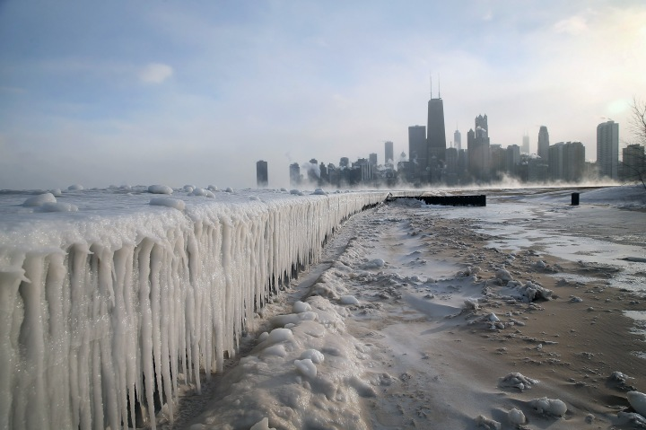 Ice builds up along Lake Michigan at North Avenue Beach as temperatures dipped well below zero on January 6, 2014 in Chicago.