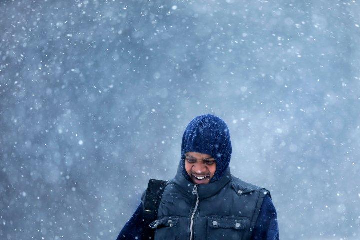 A man walks during a winter snowstorm, Jan. 21, 2014, in Philadelphia.