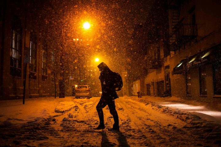 A man walks through the snow in Hoboken