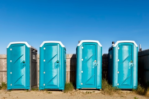Portable toilets at the beach.