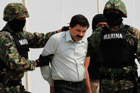 "Joaquin ""Shorty"" Guzman (C) is escorted by soldiers during a presentation at the Navy's airstrip in Mexico City"