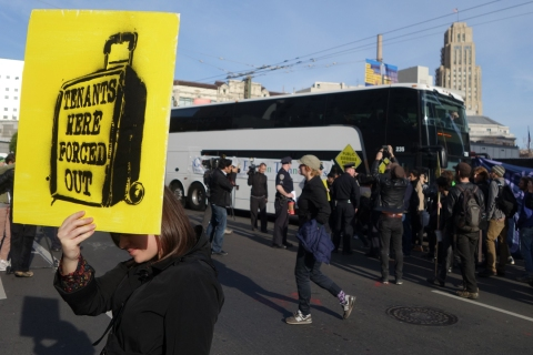 Protesters block two private shuttles transporting tech workers from their homes in San Francisco to their jobs in Silicon Valley on Jan. 21 2014. The coaches, which use public bus stops, have become a symbol of stratification in the city.