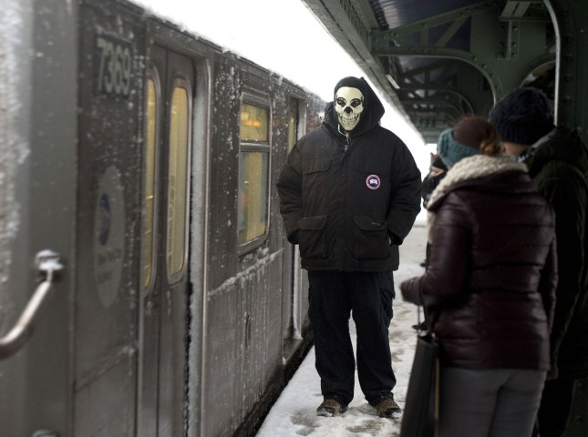 A man waits for a train at a subway station Feb.13, 2014 in New York City.